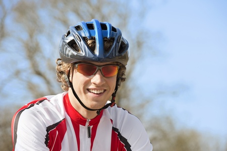 Happy bicyclist wearing goggles and crash helmet Stock Photo - 13929356