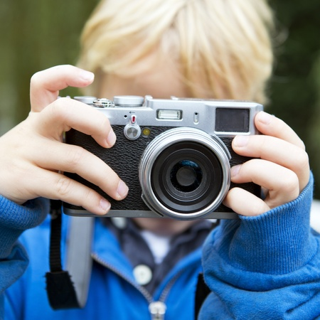 rangefinder: Young child, taking a picture using a retro rangefinder camera