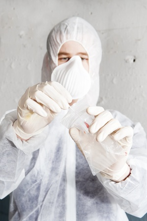 Forensic researcher putting a blood sample in an evidence bag photo