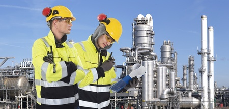 Two industrial guards checking the safety around the site,  Stock Photo