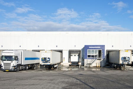 Reafers and containers at the bays or loading docks of a large distributin center Stock Photo - 18153085