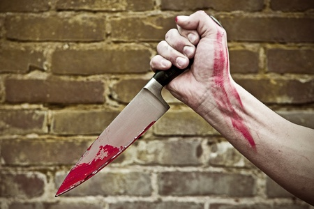 forceful: Fist, holding a blood stained knife, stabbing