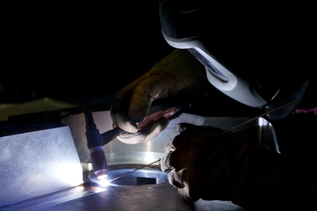 Welder, repairing a large steel part with a high precision welding technique