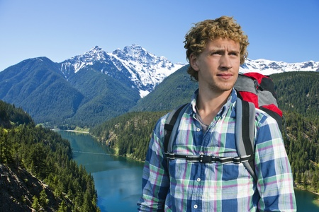 Portrait of a young hiker with Diablo Lake in the North Cascades, Washington, USA in the background