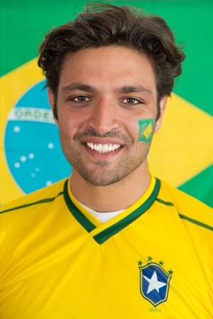 southamerica: Confident, snug looking man in the colours of the National Brazilian soccer team