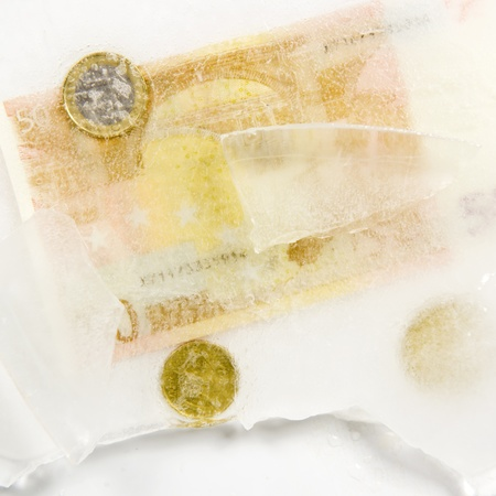 European currency frozen in ice photo