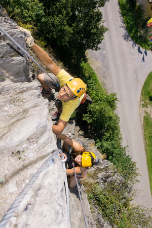 recreational climbing: High angle view of man and woman climbing rock Stock Photo