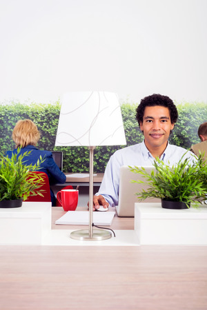 lady with the lamp: Portrait of confident environmentalist sitting at desk in office