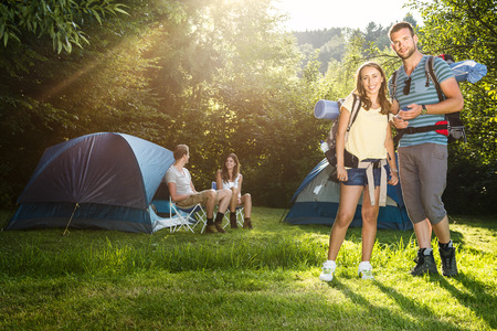 sports shoe: Young couple together on the camping going hiking in the sunny afternoon