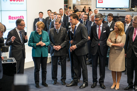 messe: HANOVER, GERMANY - APRIL 7: German Chancellor Angela Merkel during a technology showcase tour of industrial Robotics by Bosch and Rexroth at the Hannover Messe