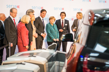 messe: HANOVER, GERMANY - APRIL 7: German Chancellor Angela Merkel during a technology showcase tour of innovations in industrial Robotics used in the Automotive industry. Editorial
