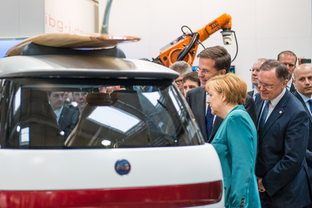 chancellor: HANOVER, GERMANY - APRIL 7: German Chancellor Angela Merkel during a technology showcase tour of innovations in industrial Robotics used in the Automotive industry. Editorial