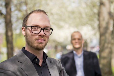 aide: Portrait of a creative business professional, with his aide behind him in the background Stock Photo