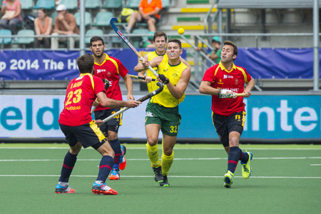 preliminary: THE HAGUE, NETHERLANDS - JUNE 2: Australian Hayward lifts his stick to control a high bal, surrounded by Spanish players during the Hockey World Cup 2014 in the preliminary match between Australia and Spain (men). AUS beats SPA 3-0