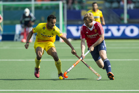 battling: THE HAGUE, NETHERLANDS - JUNE 2: English field hockey player Ashley Jackson crosses sticks with an unidentified Indian player at the Rabobank World Cup Hockey. ENG beats IND 2-1