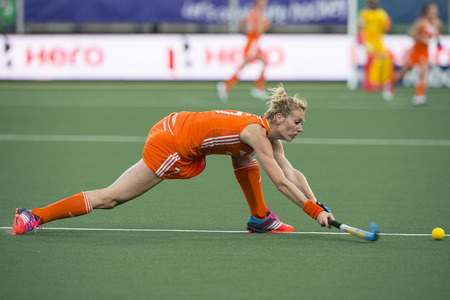 ball stretching: THE HAGUE, NETHERLANDS - JUNE 2: Willemijn Bos (Netherlands) strikes the ball, stretching deep, during the match against Belgium at the World Cup Hockey. NED beats BEL 4-0