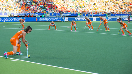 attacker: THE HAGUE, NETHERLANDS - JUNE 2: Dutch van As is tanking a corner during the match The Netherlands - Belgium during the Hockey World Cup 2014 in the preliminary match between The Netherlands and Belgium (woman) NED beats BEL 4-0