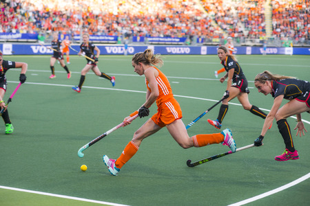 preliminary: THE HAGUE, NETHERLANDS - JUNE 2: Dutch Hoog is controling the ball with her stick, Belgium player de Groof is trying to take over the ball during the Hockey World Cup 2014 in the preliminary match between The Netherlands and Belgium (woman) NED beats BEL
