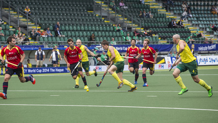 preliminary: THE HAGUE, NETHERLANDS - JUNE 2: Australian Orchard is passing the Spanish defence during the Hockey World Cup 2014 in the preliminary match between Australia and Spain (men). AUS beats SPA 3-0 Editorial