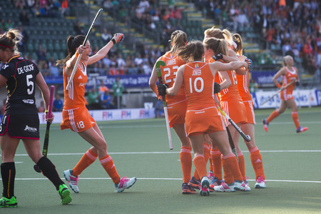 attacker: THE HAGUE, NETHERLANDS - JUNE 2: Dutch players van As, Lammers, Jonker and Hoog celebrating a goal during the Hockey World Cup 2014 in the preliminary match between The Netherlands and Belgium. NED beats BEL 4-0