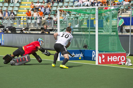 wesley: THE HAGUE, NETHERLANDS - JUNE 1: German field hockey player Wesley races in for the rebound on Straikowskis second goal against South Africa. Goalie Robinson (RSA) is too late Editorial
