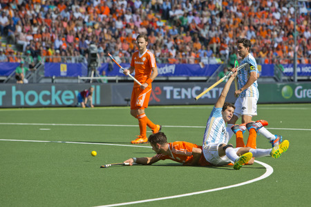 commits: HE HAGUE, NETHERLANDS - JUNE 1: Argentinian Defender Lopez commits a foul on Dutch player Kemperman during the World Cup Hockey, resulting in a penalty corner. The appeal is useless. NED beats ARG 3-1 Editorial