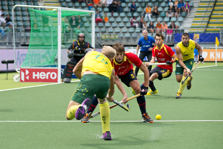 attacker: THE HAGUE, NETHERLANDS - JUNE 2: Bosco Perez-Pla (ESP) fails to block Australian attacker Deavin, passing to Ciriello during the World Cup Hockey match between Australia and Spain (3-0) on June 2, 2014