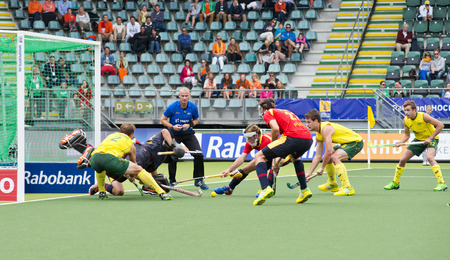 vigorously: THE HAGUE, NETHERLANDS - JUNE 2: Chaos reigns as Spain vigorously defends a penalty corner by Australia during the World Cup Hockey,  Editorial