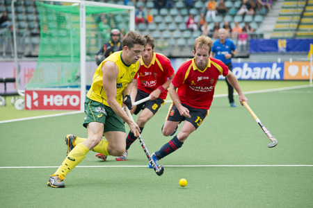 ruiz: THE HAGUE, NETHERLANDS - JUNE 2: Simon Orchard (AUS) tris to find a way through the Spanish Defense (Ruiz and Alegre) during the World Cup Hockey. AUS beats SPA 3-0