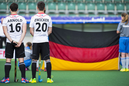 ger: THE HAGUE, NETHERLANDS - JUNE 1: The German hockey team is lined up with the flag during the Hockey World Cup 2014 (men)