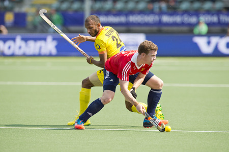 attacker: THE HAGUE, NETHERLANDS - JUNE 2: England Defender Hoare (in posession of the ball) turns away from Indian Attacker Sunil during the World Cup Hockey. England beats India 2-1
