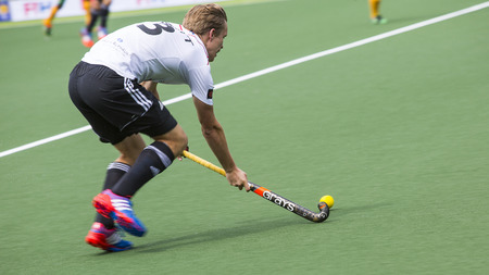 ger: THE HAGUE, NETHERLANDS - JUNE 1: German player Butt is playing the ball during the Hockey World Cup 2014 in the match between Germany and South Africa. GER beats RSA  4-0