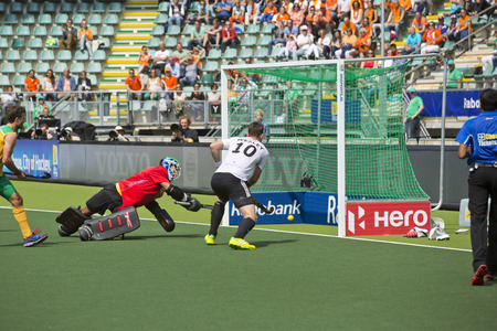 ger: THE HAGUE, NETHERLANDS - JUNE 1: German player Wesley scores the 4-0 during the Hockey World Cup 2014 in the match between Germany and South Africa. GER beats RSA 4-0 Editorial