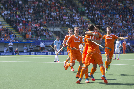 attacker: THE HAGUE, NETHERLANDS - JUNE 1: Dutch players celebrating a goal during the Hockey World Cup 2014 in the match between The Netherlands and Argentina (men). NED beats ARG 3-0 Editorial