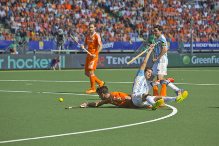 attacker: THE HAGUE, NETHERLANDS - JUNE 1: Dutch player Kemperman is tackeled by Argentinian player Gilardi during the Hockey World Cup 2014 in the match between The Netherlands and Argentina (men). NED beats ARG 3-0