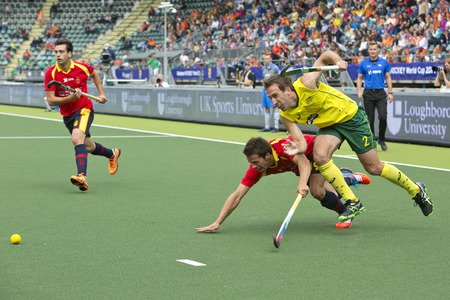 esp: THE HAGUE, NETHERLANDS - JUNE 2: Liam de Young (AUS) and Marc Salles (ESP) struggle to reach the ball first at the World Cup Hockey 2014. Australia beats Spain 3-0 Editorial