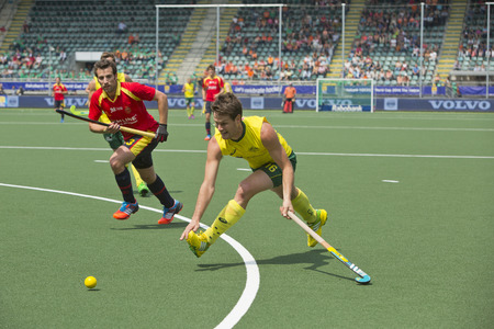 defender: THE HAGUE, NETHERLANDS - JUNE 2: Matt Ghodes (AUS) tries to cross the ball using a backhand strike whilst Spanish Defender Sergi Enrique rushes in to block the shot. AUS beats SPA 3-0