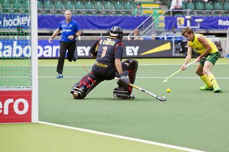 esp: THE HAGUE, NETHERLANDS - JUNE 2: Jacob Whetton (AUS) Faces the Spanish goalie Quinco Cortes during the World Cup Hockey match between Spain and Australia. AUS beats ESP 3-0