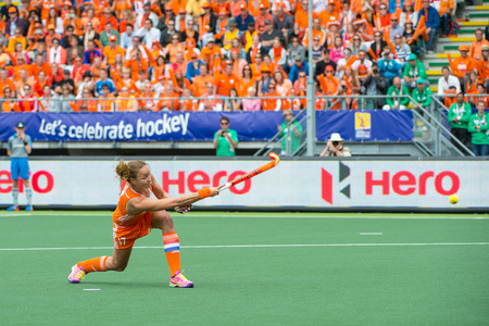 finals: THE HAGUE, NETHERLANDS - JUNE14: Captain Maartje Paumen of the Dutch womens field hockey team scores 1-0 against Australia during the finals of the Rabobank Hockey World Cup. Editorial