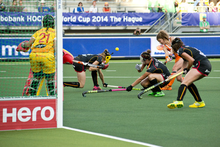 attempts: THE HAGUE, NETHERLANDS - JUNE 2: Belgian Defenders duck away when Dorst (NED) attempts a shot at goal after a penalty corner during the World Cup Hockey match between Netherlands and Belgium (NED beats BEL 4-0)