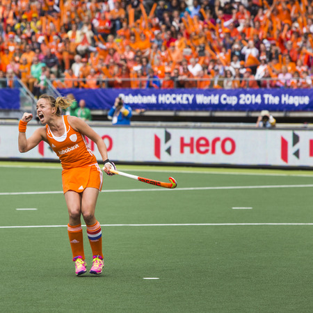 scoring: THE HAGUE, NETHERLANDS - JUNE 14: Dutch captain Maartje Paumen raises her fists after scoring a penalty push, giving Netherlands the lead in the finals of the World Championships Hockey against Australia