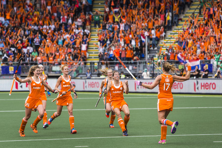 matchmaker: THE HAGUE, NETHERLANDS - JUNE 14: Maartje Paumen (NED) runs back to cheer with her team after scoring 1-0 from a penalty push against Australia during the finals of the World Championships Hockey Editorial