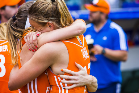 winning pitch: THE HAGUE, NETHERLANDS - JUNE 14: Dutch team captain Maartje Paumen cant surpress her tears of joy after winning the world championships hockey 2014