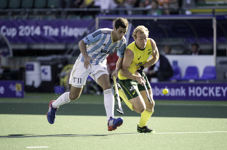 joaquin: THE HAGUE, NETHERLANDS - JUNE 13: Australian player Zalewski is fighting for the ball with Argentinian player Menini during the semi-finals of the world championships hockey 2014. AUS wins 5-1 Editorial
