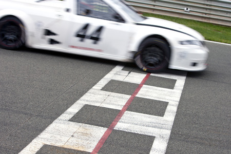 Race car crossing the finish line on a circuit photo