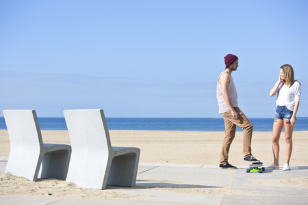 seem: Encounter between a boy and a girl on a beach; both seem positively interested in each other