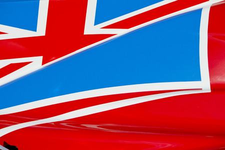 body work: The colors and crest of the national flag of Great Britain painted on the body work of a race car Stock Photo