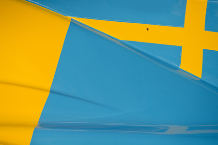body work: The colors and crest of the national flag of Sweden painted on the body work of a race car Stock Photo