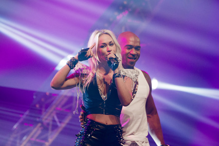 producing: ASSEN, NETHERLANDS - OCTOBER 17, 2014: Dutch Eurodance Act Twenty 4 Seven performs on stage during a 80s and 90s party, hosted by David Hasselhoff. Editorial