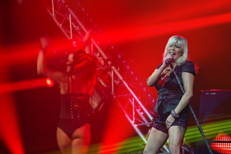 assen: ASSEN, NETHERLANDS - OCTOBER 17, 2014: Samantha Fox performs on stage during the 80s and 90s party in the TT Hall during the acceleration dance event. Editorial